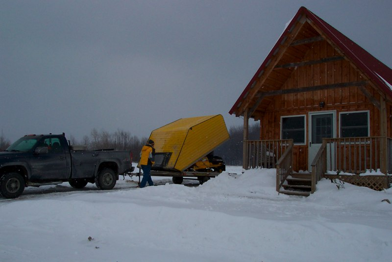 Snowmobile on a snowmobile trailer at one of our cabins.