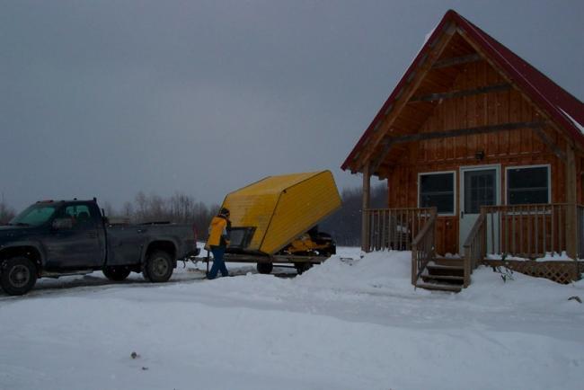 Snowmobiles unloading